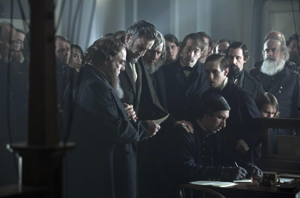 LINCOLN, Bruce McGill (left), Daniel Day-Lewis as President Abraham Lincoln (center), Grainger Hines (right of center), Adam Driver (sitting, front), 2012, ph: David James/TM and Copyright ©20th Century Fox Film Corp. All rights reserved.