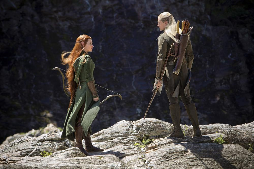 THE HOBBIT: THE DESOLATION OF SMAUG, from left: Evangeline Lilly, Orlando Bloom, 2013. ph: James Fisher/©Warner Bros. Pictures
