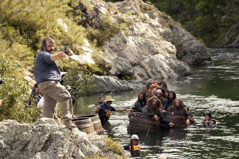 THE HOBBIT: THE DESOLATION OF SMAUG, front: director Peter Jackson, in barrels, front, from left: Jed Brophy, Dean O'Gorman, second row, from left: Richard Armitage, Graham McTavish, Aidan Turner, on set, 2013. ph: James Fisher/©Warner Bros. Pictures