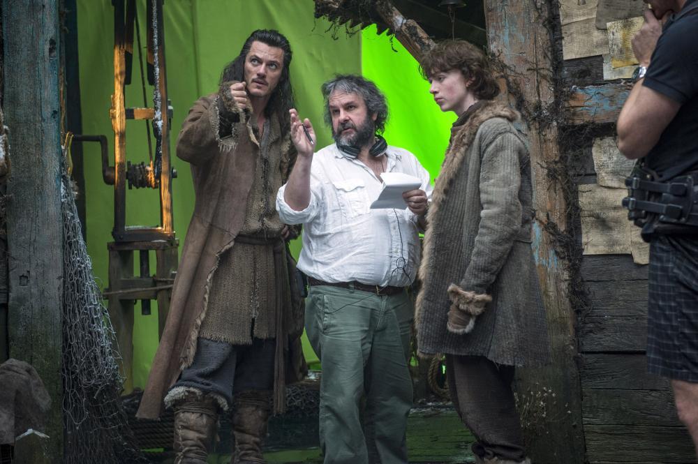 THE HOBBIT: THE DESOLATION OF SMAUG, from left: Luke Evans, director Peter Jackson, John Bell, on set, 2013. ph: Mark Pokorny/©Warner Bros. Pictures