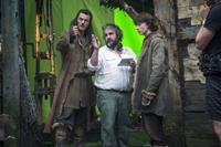 THE HOBBIT: THE DESOLATION OF SMAUG, from left: Luke Evans, director Peter Jackson, John Bell, on set, 2013. ph: Mark Pokorny/©Warner Bros. Pictures