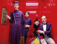 THE GRAND BUDAPEST HOTEL, from left: Paul Schlase, Tony Revolori, Tilda Swinton, Ralph Fiennes, 2014. ph: Martin Scali/TM and Copyright ©Fox Searchlight Pictures