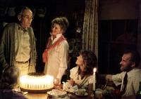 ON GOLDEN POND, Henry Fonda, Katharine Hepburn, Jane Fonda, Dabney Coleman, 1981, blowing out candles on the birthday cake