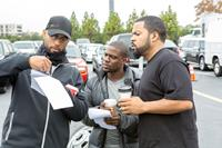 RIDE ALONG, from left: director Tim Story, Kevin Hart, Ice Cube, on set, 2014. ph: Quantrell D. Colbert/©Universal Pictures