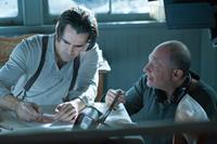 WINTER'S TALE, l-r: Colin Farrell, director Akiva Goldsman, 2014, ph: David C. Lee/©Warner Bros. Pictures