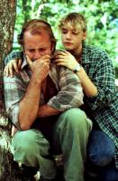 IN COUNTRY, Bruce Willis being comforted by Emily Lloyd, 1989