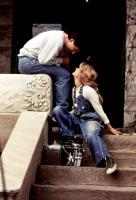 PRELUDE TO A KISS,  TM and Copyright (c) 20th Century Fox Film Corp. All rights reserved. Alec Baldwin, Meg Ryan, 1992, flirting on the steps
