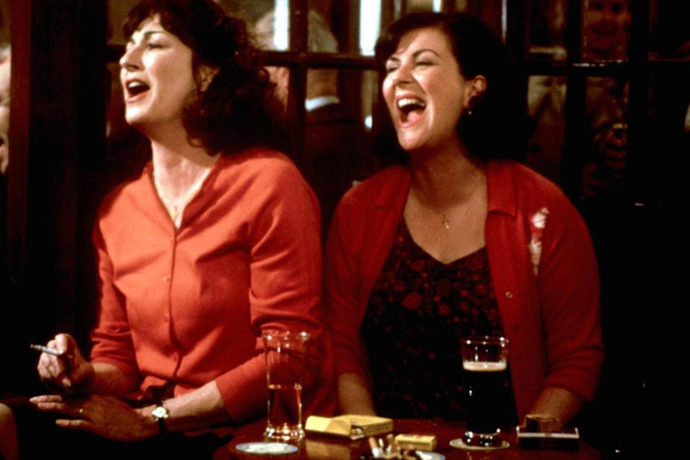 AGNES BROWNE, Anjelica Huston, Marion O'Dwyer, 1999, laughing at the pub