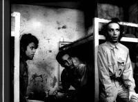 DOWN BY LAW, Tom Waits, John Lurie, Roberto Benigni, 1986, sitting in prison cell