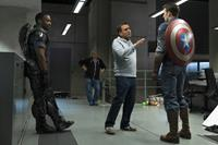 CAPTAIN AMERICA: THE WINTER SOLDIER, from left: Anthony Mackie, director Joe Russo, Chris Evans, 2014. ph: Zade Rosenthal/©Walt Disney Studios Motion Pictures