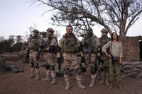 SEAL TEAM EIGHT: BEHIND ENEMY LINES, Tom Sizemore (left), Langley Kirkwood (left of center), Lex Shrapnel (front, center), Eugene Khumbanyiwa (right of center), Tanya van Graan (right), 2014. TM and ©Twentieth Century Fox Film Corporation. All rights reser