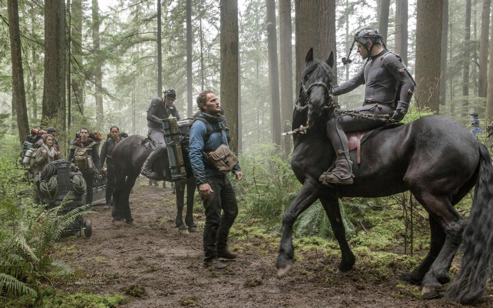 DAWN OF THE PLANET OF THE APES, Jason Clarke (center), Andy Serkis (right), 2014. ph: David James/TM and ©Copyright Twentieth Century Fox Film Corporation. All rights reserved.