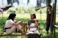 CRAZY IN ALABAMA, Melanie Griffith, Sandra Seacat, Lucas Black, 1999, sitting on the swing