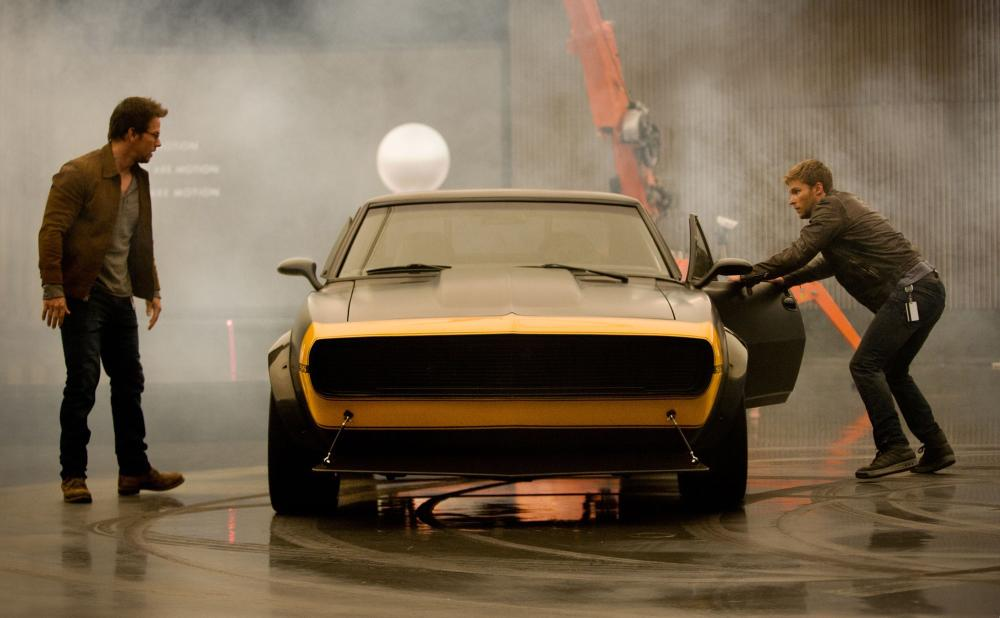 Left to right: Mark Wahlberg plays Cade Yeager and Jack Reynor plays Shane Dyson with Bumblebee (center, as a highly modified, vintage 1967 Camaro SS) in TRANSFORMERS: AGE OF EXTINCTION, from Paramount Pictures.