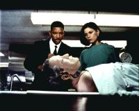 MEN IN BLACK, Will Smith, Linda Fiorentino, 1997, examining the corpse