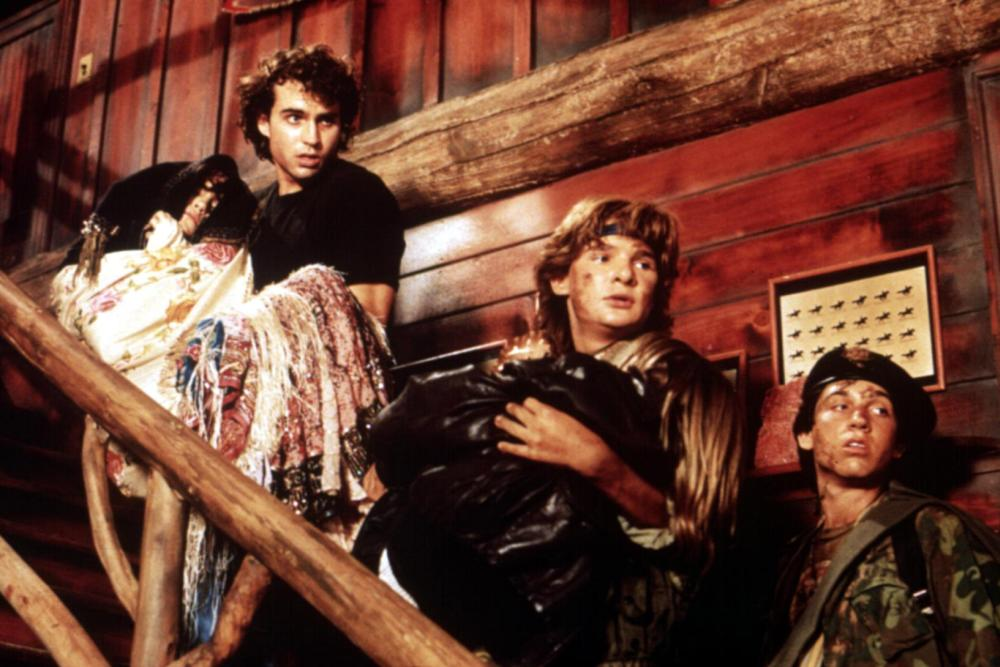 THE LOST BOYS, Jason Patric, Jami Gertz, (Tony Cain being carried by Corey), Corey Feldman, Jamison Newlander, 1987. ©Warner Bros.