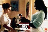 WOMAN ON TOP, Penelope Cruz (left), Murilo Benicio (in photograph), Harold Perrineau, 2000, TM & © 20th Century Fox Film Corp.