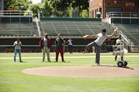 MILLION DOLLAR ARM, from left: Pitobash, Gregory Alan Williams, Bill Paxton, Jon Hamm (suit), Suraj Sharma, Madhur Mittal, 2014. ph: Ron Phillips/©Walt Disney Studios Motion Pictures