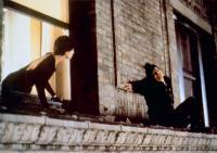 WHISPERS IN THE DARK, from left: Annabella Sciorra, John Leguizamo, 1992. ©Paramount