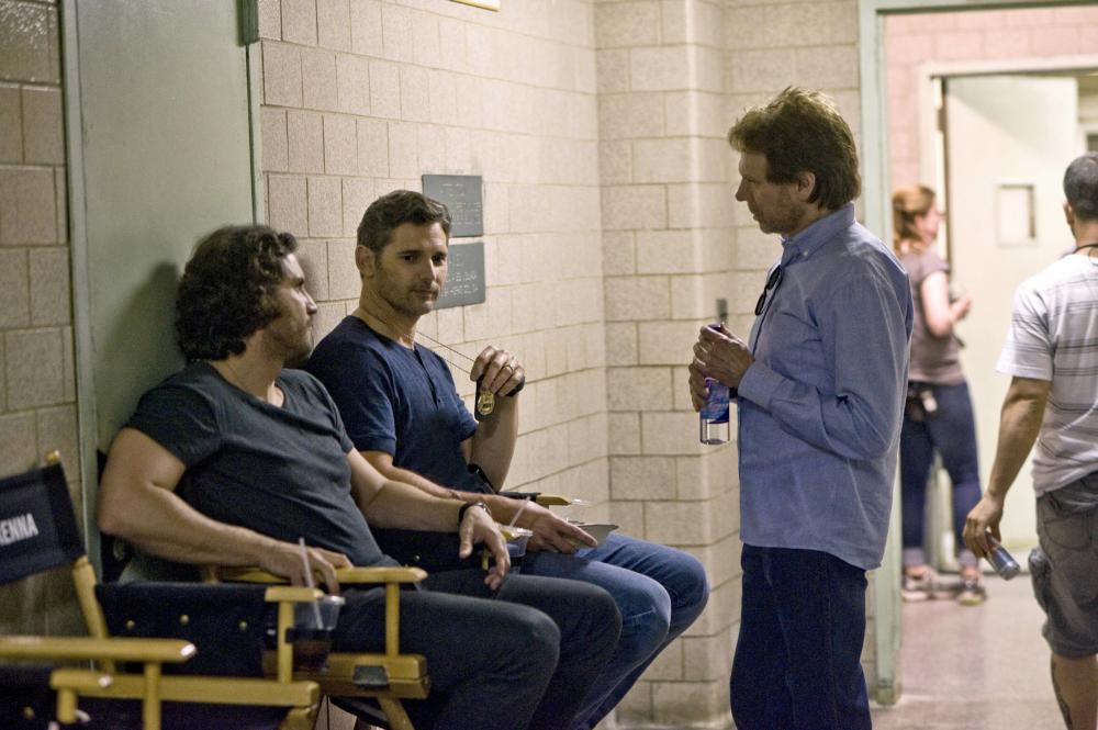 DELIVER US FROM EVIL, from left: Edgar Ramirez, Eric Bana, producer Jerry Bruckheimer, on set, 2014. ph: Andrew Schwartz/©Screen Gems
