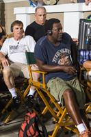 WHEN THE GAME STANDS TALL, from left: coach Bob Ladouceur, producer David Zelon, director Thomas Carter, on set, 2014. ph: Tracy Bennett/©TriStar Pictures