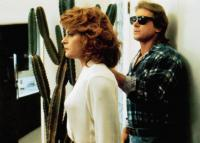 THEY LIVE, from left, Meg Foster, Roddy Piper, 1988, ©Universal