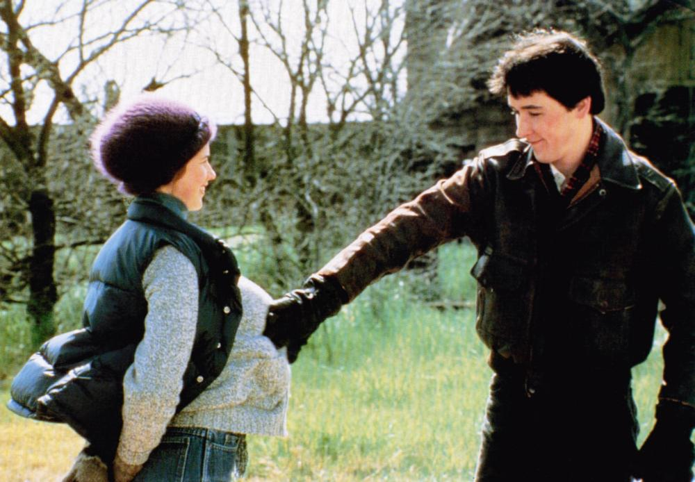THE SURE THING, from left: Daphne Zuniga, John Cusack, 1985, © Embassy Pictures