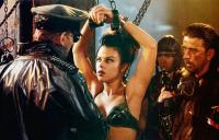 SPACE TRUCKERS, Charles Dance (back to camera), Debi Mazar (handcuffed), 1996, © TriPictures