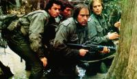 SOUTHERN COMFORT, from left: Lewis Smith, Alan Autry (rear), Powers Boothe, Keith Carradine, 1981, TM & Copyright © 20th Century Fox Film Corp.