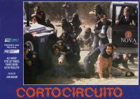 SHORT CIRCUIT, Alley Sheedy (pointing), Steve Guttenberg (pink shirt), G.W. Bailey (bullhorn), Austin Pendleton (in truck), 1986, (c) TriStar