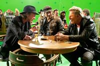 SIN CITY: A DAME TO KILL FOR, from left: directors Frank Miller, Robert Rodriguez, Mickey Rourke, on set, 2014. ©Dimension Films