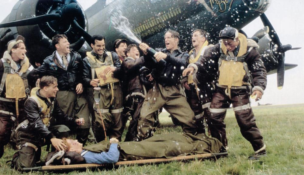 MEMPHIS BELLE, Eric Stoltz (on stretcher), Billy Zane (mustache), Matthew Modine (with bottle), 1990, © Warner Brothers