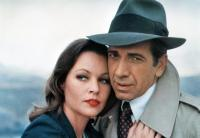 THE MAN WITH BOGART'S FACE, from left: Michelle Phillips, Robert Sacchi, 1980. ©20th Century-Fox Film Corporation, TM & Copyright