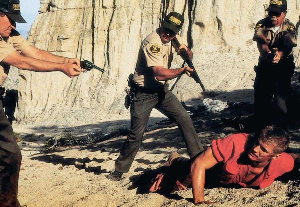 JOSHUA TREE, (aka ARMY OF ONE), Dolph Lundgren (on ground), 1993, © Vision International