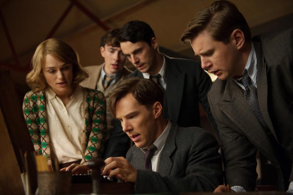 THE IMITATION GAME, seated: Benedict Cumberbatch as Alan Turing; standing from left: Keira Knightley, Matthew Beard, Matthew Goode, Allen Leech, 2014. ph: Jack English/© Weinstein Company