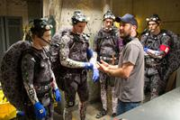 TEENAGE MUTANT NINJA TURTLES, director Jonathan Liebesman (front right), in costume, from left: Noel Fisher as Michelangelo, Pete Ploszek as Leonardo, Jeremy Howard as Donatello, Alan Ritchson as Raphael, on set, 2014. Ph: David Lee/©Paramount Pictures