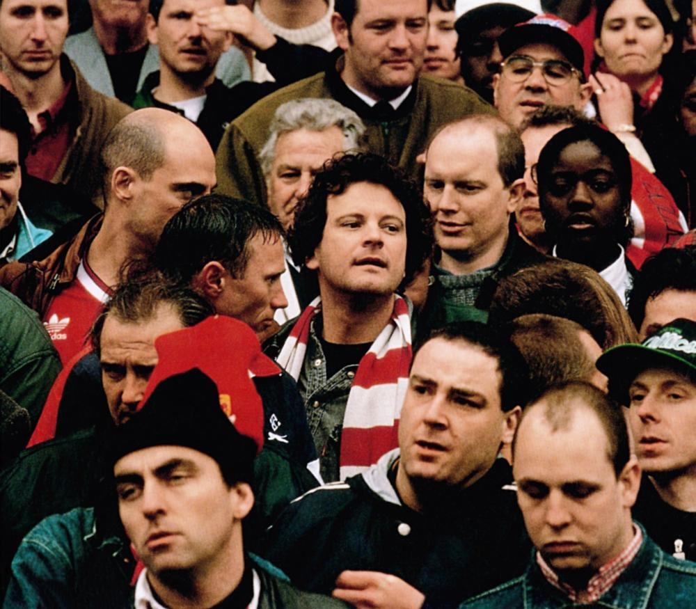 FEVER PITCH, Colin Firth (striped scarf), Nick Hornby (behind Firth right), 1997, © Phaedra Cinema