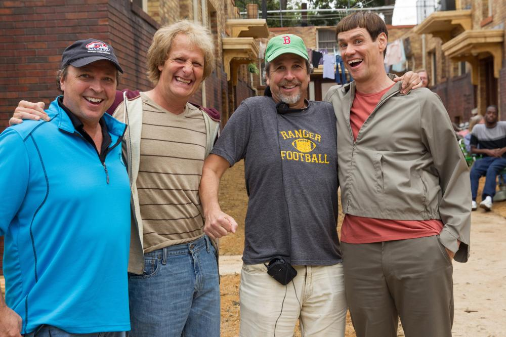 DUMB AND DUMBER TO, from left: director Bobby Farrelly, Jeff Daniels, director Peter Farrelly, Jim Carrey, on set, 2014. ph: Hopper Stone/©Universal Pictures