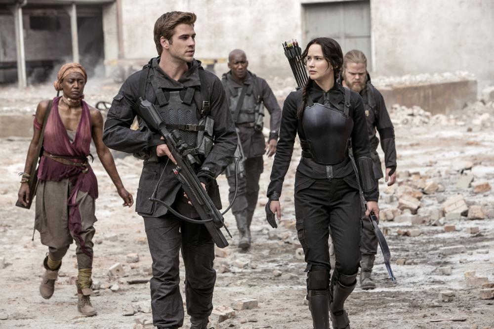 THE HUNGER GAMES: MOCKINGJAY - PART 1, from left: Patina Miller, Liam Hemsworth, Mahershala Ali, Jennifer Lawrence, 2014. ph: Murray Close/©Lionsgate