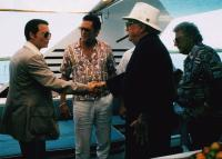 DONNIE BRASCO, shaking hands from left: Johnny Depp, Robert Miano, Michael Madsen (center), 1997, © TriStar