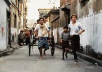 CITY OF JOY, from center:   Om Puri, Imran Badsah Khan, Patrick Swayze, 1992. ©Tri-Star Pictures