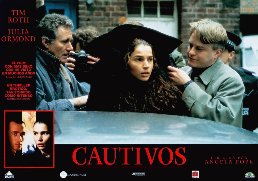 CAPTIVES, (aka CAUTIVOS), bottom from left: Tim Roth, Julia Ormond, Julia Ormond (center black coat), 1994, © Miramax