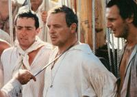 THE BOUNTY, from left: John Sessions, Anthony Hopkins,  Liam Neeson, 1984. ©Orion