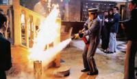 BLAME IT ON THE BELLBOY, Bronson Pinchot (with fire extinguisher), 1992, © Buena Vista