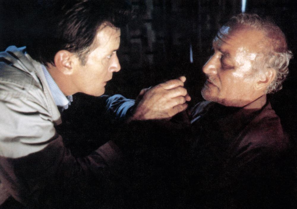 THE BELIEVERS, from left: Martin Sheen, Robert Loggia, 1987. ©Orion Pictures