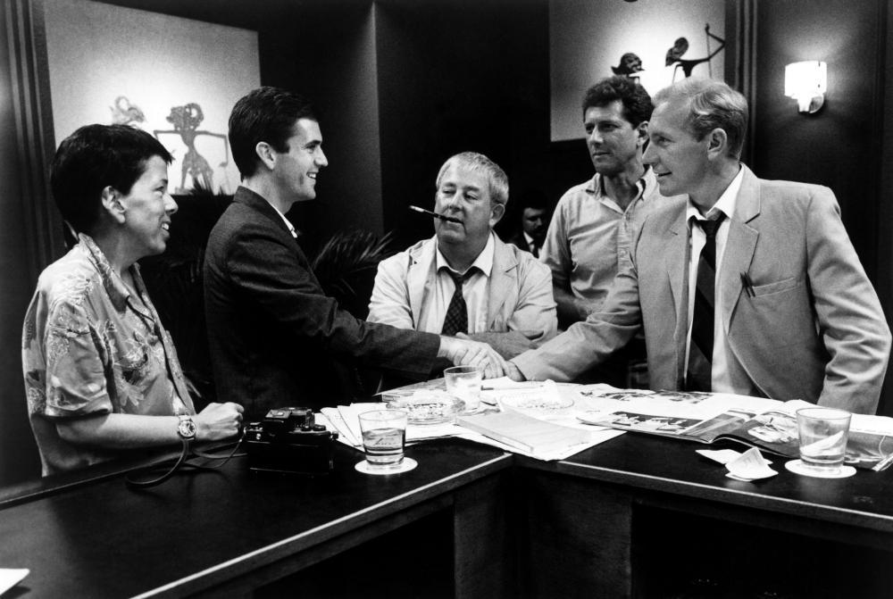 THE YEAR OF LIVING DANGEROUSLY, (l-r): Linda Hunt, Mel Gibson, Noel Ferrier, Michael Murphy, Paul Sonkkila, 1982, (c)MGM